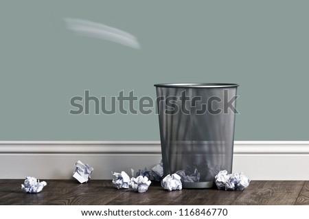 office garbage near metal basket