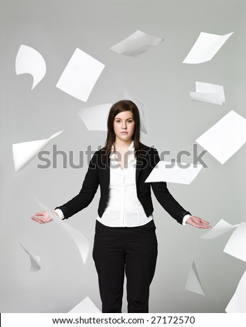 Office girl with a lots of papers flying around