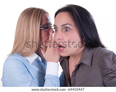 Office gossip concept. Two young girls whispering. Hi-res files, work path included