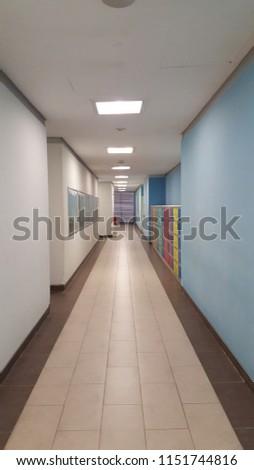 Office hallway toward elevators #1151744816