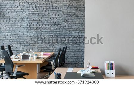 office interior behind brick wall