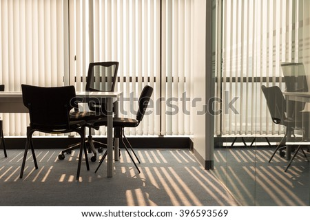 Office interior with light shining through window blinds Stock photo ©