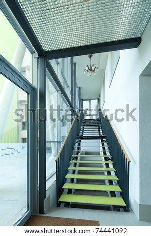 Office interior with modern stairs