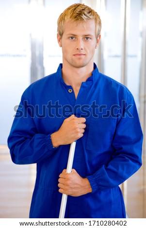 Office janitor portrait, medium shogt