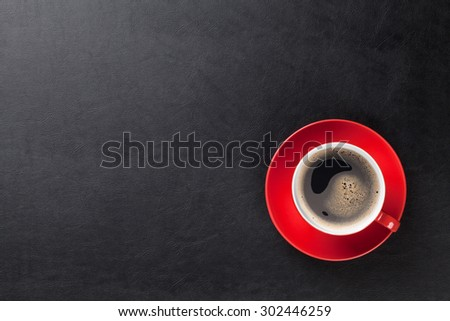 Office leather desk table with coffee cup. Top view with copy space