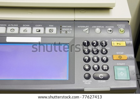 Office life: photocopier detail, close look of the digital display and numeric pad.