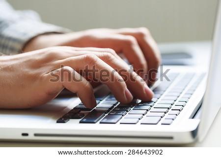 Office man hand on laptop keyboard #284643902