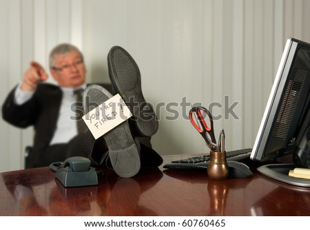 Office manager firing an employee with a yellow sticky note on his