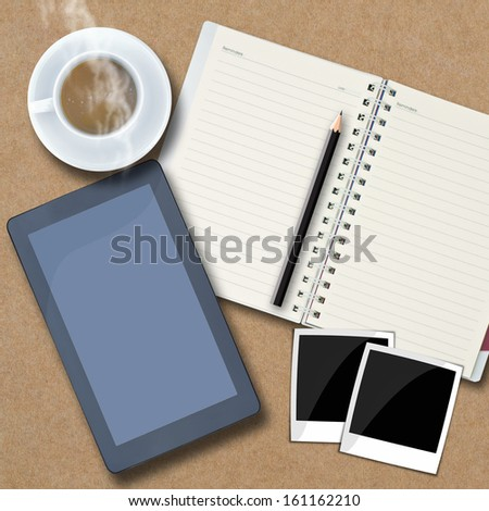 Office objects , notepad, tablet computer, photo frames, coffee cup on background.
