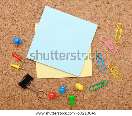 office objects over brown cork background