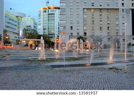 office park with water games at night