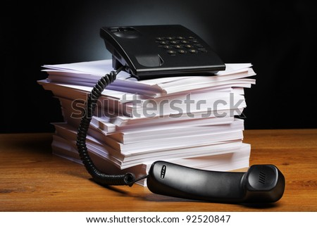 Office, phone with the removed tube on a pile of papers