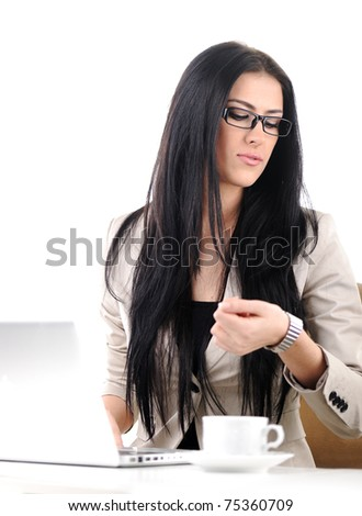 Office portrait of beautiful young business woman looking at her wrist watch