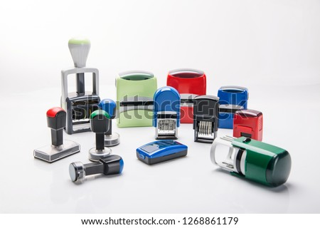 Office rubber stamp. Mechanism of a rubber stamp on a white background.  #1268861179