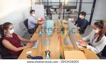 Office setting in studio, Businessman or office worker are working and wear mask for protect Covid-19 or corona virus disease but business must be continuous, healthcare concept
