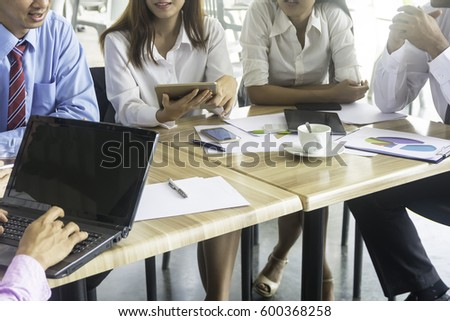 Office staff are meeting the company's portfolio summary with technology device , business concept #600368258