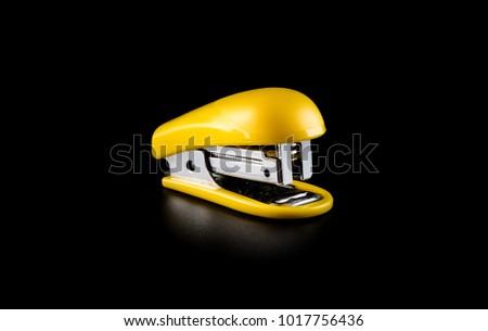 Office stapler on a black background