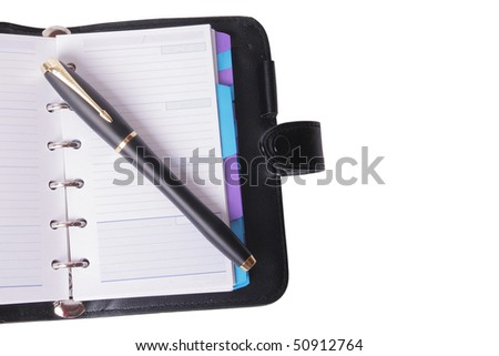 Office still-life (pen and planner) on white background (isolated)