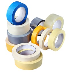 Office supplies, a set of rolls adhesive tape, paper, plastic, various colors and thickness for various purposes, isolated on white background