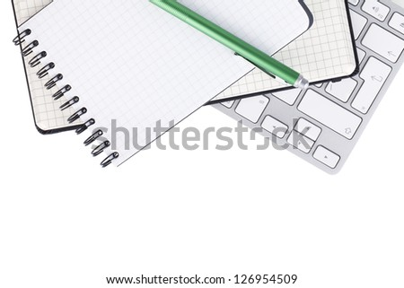 Office supplies and computer keyboard. View from above. Isolated on white background