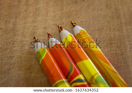 Office supplies as a background. Multi-colored slate pencil. Mixed colors. Art school. Bright colours. Color palette.
