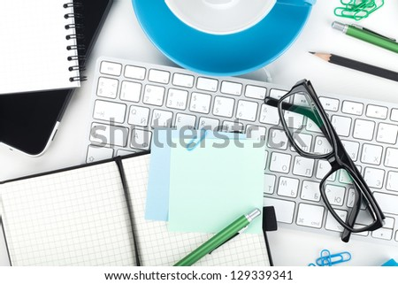 Office supplies, glasses and computer keyboard closeup