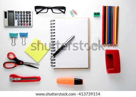 Office supplies on  wood desk background. Top view