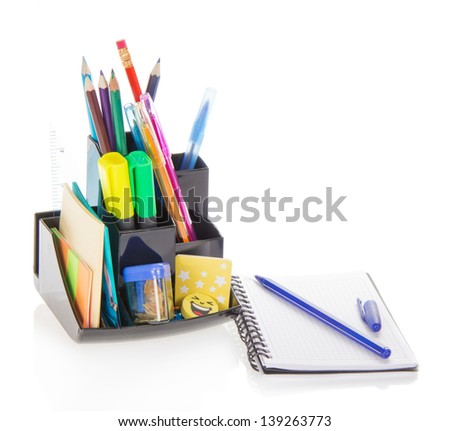 Office supply in a support and a sketchpad, isolated on white - stock photo
