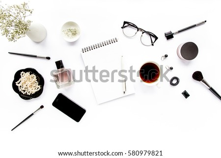 Office table desk. retro camera, glasses, phone, succulent on white background. Flat composition, magazines, social media and artists. Home office workspace. flat lay, top view