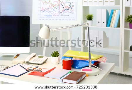 Office table with blank notepad and laptop #725201338