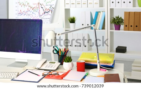 Office table with blank notepad and laptop - Shutterstock ID 739012039