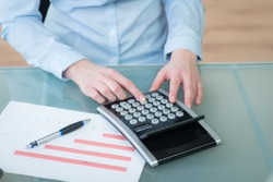 Office Table with calculator and businessplan