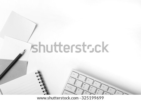 Office table with note book,paper ,pencil and computer,top view,black and white style