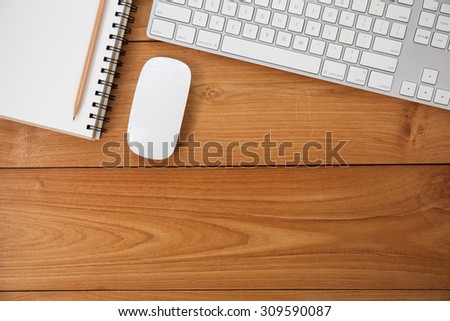 Office table with note paper, computer keyboard and mouse. View from above with copy space