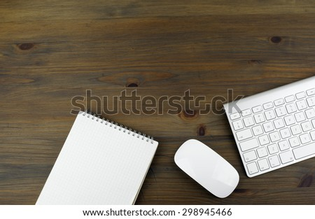 Office table with notebooks, computer and computer mouse. Free space for text or picture.