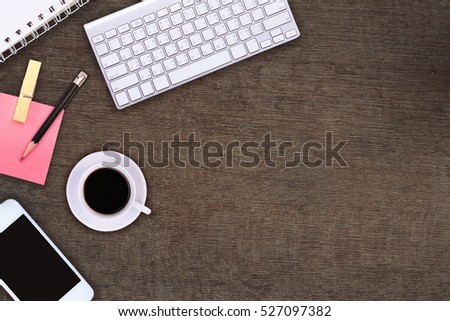 Office table with notepad, phone, computer and coffee cup. View from above with copy space #527097382