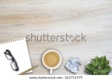 Office table with notepad, supplies,cactus flower and coffee cup. Top view with copy space #363751979