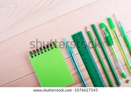 Office table with space, green stationery. Creative desk with green stationery. Office supplies products
