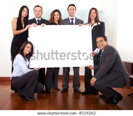 office team holding a piece of cardboard in their office