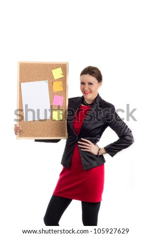 Office Team Leader - Woman in red dress and black coat holding a board with a blank paper and colorful sticky notes pinned down, easy to add custom text. Shot on white background - stock photo