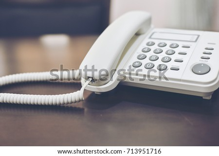 Office telephone on table,telephone on table with blur library room background #713951716