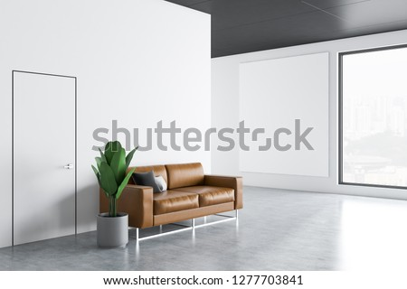 Office waiting room interior with orange walls, concrete floor, leather sofa with cushions and vertical poster hanging on the wall. 3d rendering mock up
