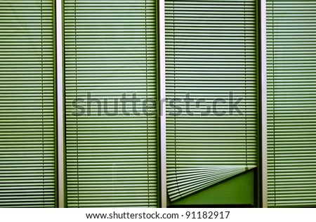 Office window with blinds or luxaflex of which one is not shut properly - privacy symbol