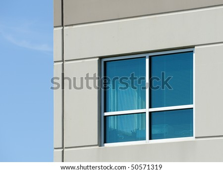 Office window with view through window to blue sky