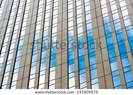 Office windows and blue sky refection.