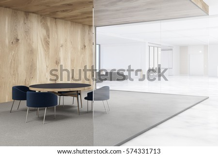 Shutterstock Office with white and wooden walls. Waiting area with a round table surrounded by armchairs. 3d rendering. Mock up.