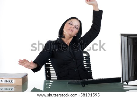 Office woman at desk stretching her arms