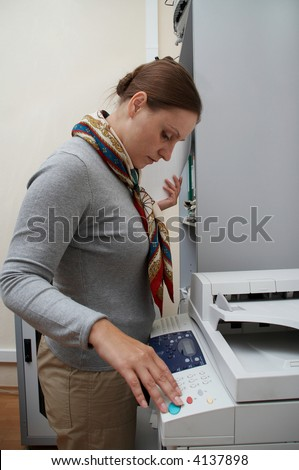 Office. Woman printing a documents. Routine.