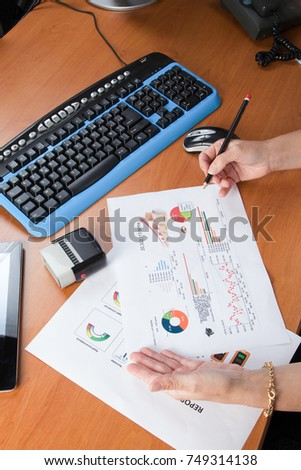 Office woman with documents reports to her office with her pen - Shutterstock ID 749314138