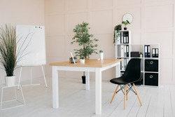 Office: wooden table, board, chairs, clock